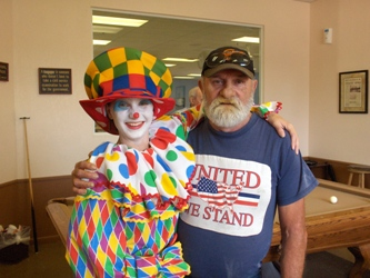 A man and a clown posing together