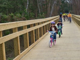 kids biking on the bridge